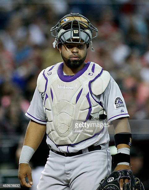 Wilin Rosario of the Colorado Rockies looks on during the third inning of an MLB game against the Arizona Diamondbacks at Chase Field on August 9...