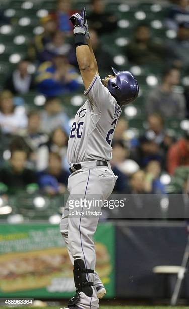 Wilin Rosario of the Colorado Rockies reacts at home plate after his home run against the Milwaukee Brewers in the tenth inning at Miller Park on...