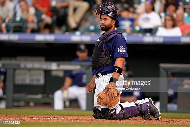 Wilin Rosario of the Colorado Rockies reacts to a fourrun fourth inning by the Washington Nationals at Coors Field Major League Baseball action...