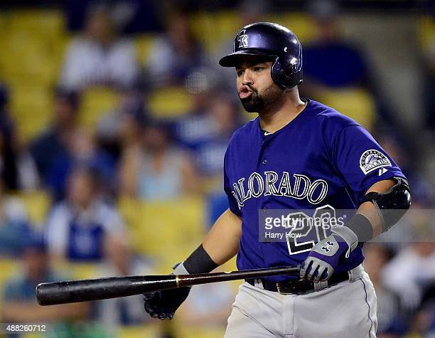 Wilin Rosario of the Colorado Rockies reacts to a strike during the ninth inning against the Los Angeles Dodgers at Dodger Stadium on September 14...
