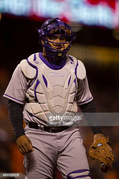 Wilin Rosario of the Colorado Rockies returns to the dugout after warming up pitcher Matt Belisle before the bottom of the eighth inning at ATT Park...