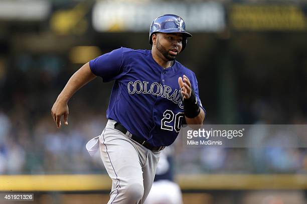 Wilin Rosario of the Colorado Rockies runs to third base during the game against the Milwaukee Brewers at Miller Park on June 28 2014 in Milwaukee...