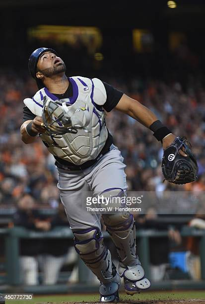 Wilin Rosario of the Colorado Rockies tracks a foul popup against the San Francisco Giants at ATT Park on June 13 2014 in San Francisco California