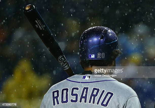Wilin Rosario of the Colorado Rockies walks back to the dugout after the game was stopped in the top of the sixth inning due to rain during the MLB...