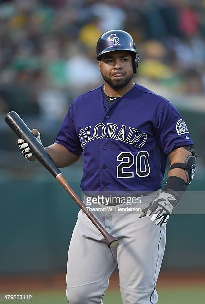 Wilin Rosario of the Colorado Rockies walks back to the dugout after striking out against the Oakland Athletics in the top of the third inning at Oco...