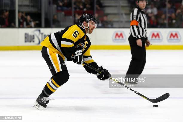 Wilkes-Barre/Scranton Penguins defenceman David Warsofsky controls the puck during the third period of the American Hockey League game between the...