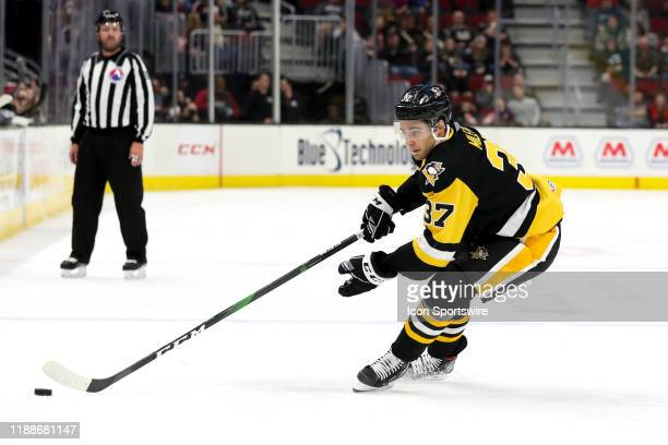 Wilkes-Barre/Scranton Penguins left wing Sam Miletic plays the puck during the first period of the American Hockey League game between the...