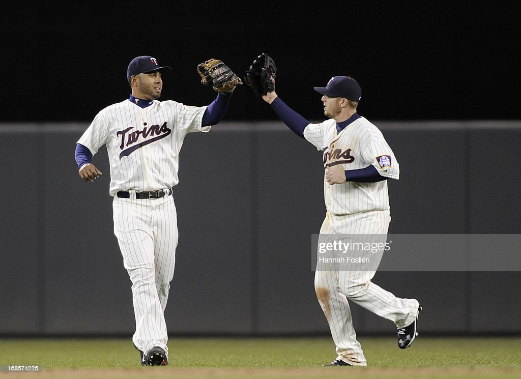 Wilkin Ramirez #22 and Chris Parmelee #27 of the Minnesota Twins celebrate a win of the game against the Baltimore Orioles on May 11, 2013 at Target Field in Minneapolis, Minnesota. The Twins defeated the Orioles 8-5.