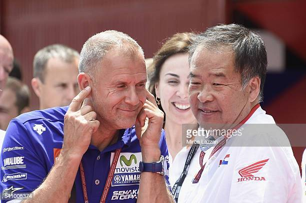 Wilko Zeelemberg of Netherland and Jorge Lorenzo Team Manager looks on and Shuhei Nakamoto of Japan and Honda Racing Competition HRC speaks at the...