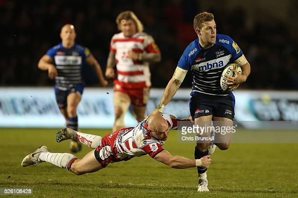 Will Addison of Sale Sharks is tackled by Willi Heinz of Gloucester Rugby during the Aviva Premiership match between Sale Sharks and Gloucester Rugby...