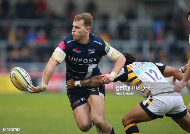 Will Addison of Sale Sharks off loads the ball under pressure from Kyle Eastmond of Wasps during the Aviva Premiership match between Sale Sharks and...