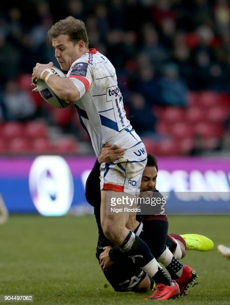 Will Addison of Sale Sharks tackled by Rudi Wolf of Lyon during the European Rugby Challenge Cup match between Sale Sharks and Lyon at the AJB...