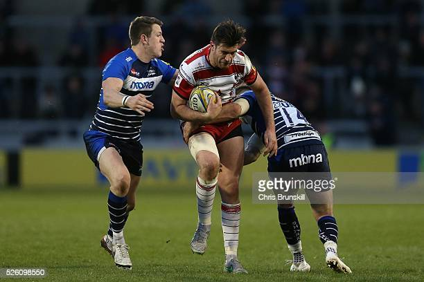 Will Addison of Sale Sharks tackles Mark Atkinson of Gloucester Rugby during the Aviva Premiership match between Sale Sharks and Gloucester Rugby at...