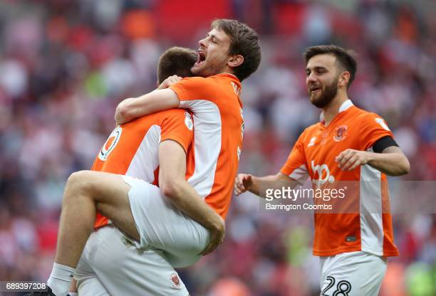 Will Aimson Andy Taylor and Jack Payne of Blackpool celebrate victory and promotion after the Sky Bet League Two Playoff Final between Blackpool and...