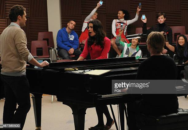 Will and Rachel sing a duet as the Glee Club watches in the Ballad episode of GLEE airing Wednesday Nov 18 on FOX Also pictured LR Mark Salling...