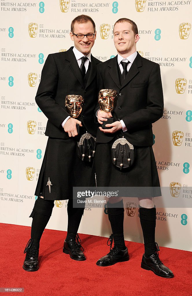 Will Anderson (2L) and Ainslie Henderson (2R), winners of the Short Animation awards for 'The Making Of Longbird', pose in the press room at the EE British Academy Film Awards at The Royal Opera House on February 10, 2013 in London, England.