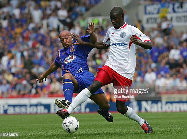 Will Antwi of Aldershot is tackled by Martin O'Connor of Shrewsbury during the Nationwide Promotional Final match between Aldershot Town and...