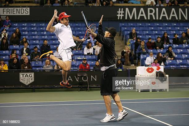 Will Arnett and Andy Roddick celebrate a point at the Maria Sharapova and Friends tennis exhibition Presented By Porsche on December 12 2015 in Los...