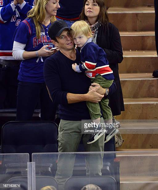 Will Arnett and son attend the New Jersey Devils vs The New York Rangers game at Madison Square Garden on April 21 2013 in New York City