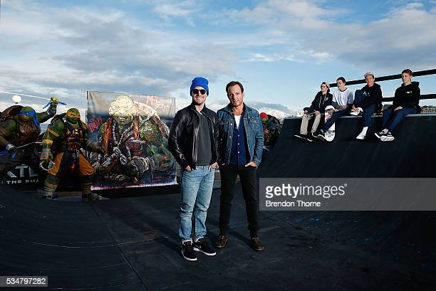 Will Arnett and Stephen Amell pose at Bondi beach during a photo call ahead of the Australian premiere of Teenage Mutant Ninja Turtles 2 on May 28...