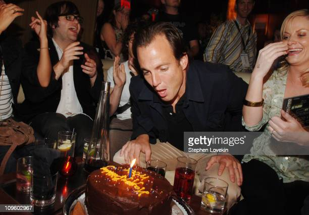 Will Arnett blows out the candle on his birthday cake