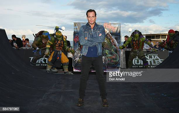 Will Arnett poses pose during a photo call ahead of the Australian premiere of Teenage Mutant Ninja Turtles 2 on May 28 2016 in Sydney Australia