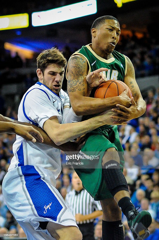 Will Artino #31 of the Creighton Bluejays fights with Isiah Jones #23 of the UAB Blazers during their game at CenturyLink Center on November 14, 2012 in Omaha, Nebraska.