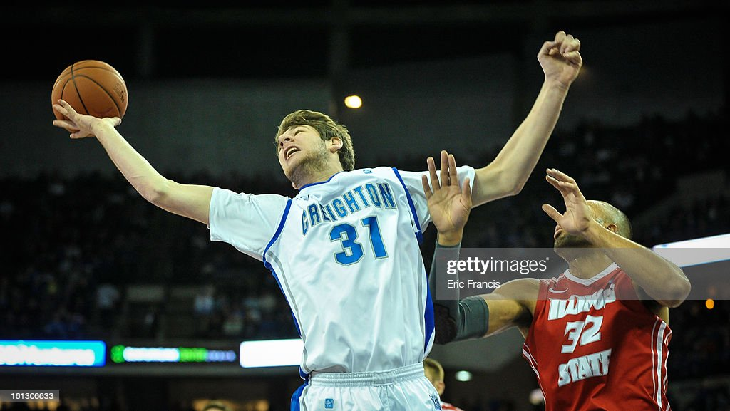 Will Artino #31 of the Creighton Bluejays reaches for a rebound over Jackie Carmichael #32 of the Illinois State Redbirds during their game at the CenturyLink Center on February 9, 2013 in Omaha, Nebraska.