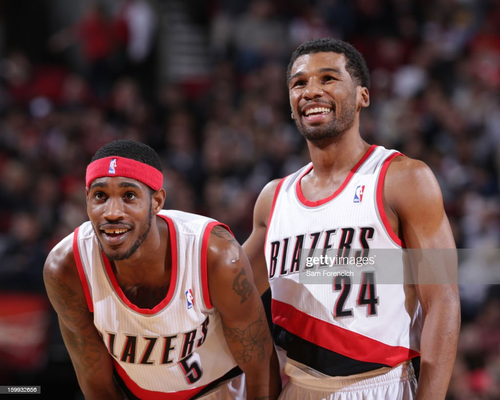 Will Barton #5 and Ronnie Price #24 of the Portland Trail Blazers smile during the game against the Washington Wizards on January 21, 2013 at the Rose Garden Arena in Portland, Oregon.