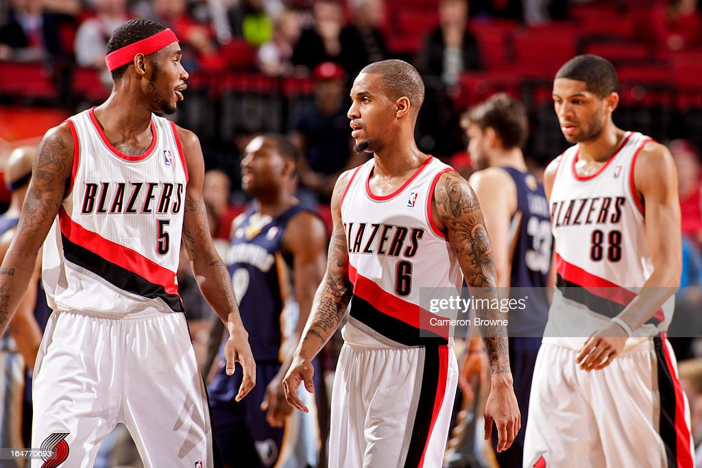 Will Barton #5, Eric Maynor #6 and Nicolas Batum #88 of the Portland Trail Blazers walk to the sideline for a timeout during a game against the Memphis Grizzlies on March 12, 2013 at the Rose Garden Arena in Portland, Oregon.