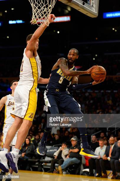 Will Barton of the Denver Nuggets attempts a pass around Brook Lopez of the Los Angeles Lakers on November 19 2017 at STAPLES Center in Los Angeles...