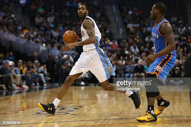 Will Barton of the Denver Nuggets controls the ball against Dion Waiters of the Oklahoma City Thunder at Pepsi Center on April 5 2016 in Denver...