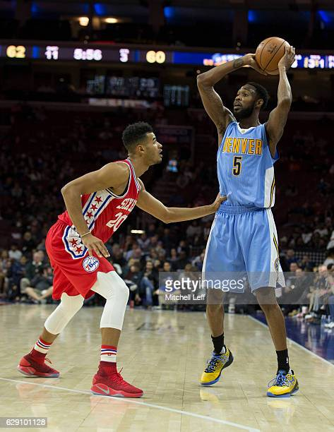 Will Barton of the Denver Nuggets controls the ball against Timothe LuwawuCabarrot of the Philadelphia 76ers at Wells Fargo Center on December 5 2016...