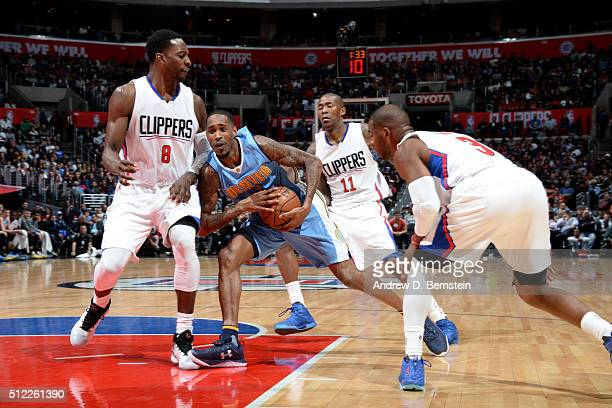 Will Barton of the Denver Nuggets drives through the Los Angeles Clippers defense at STAPLES Center on February 24 2016 in Los Angeles California...