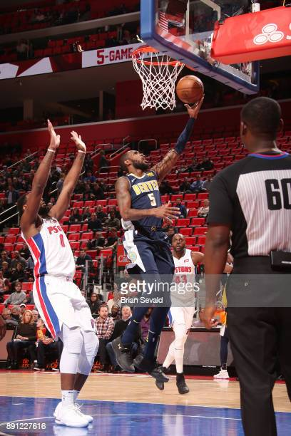 Will Barton of the Denver Nuggets drives to the basket against the Detroit Pistons on December 12 2017 at Little Caesars Arena in Detroit Michigan...