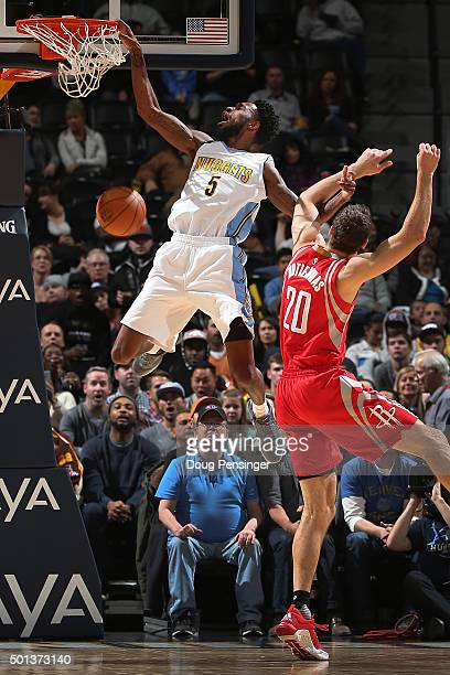 Will Barton of the Denver Nuggets dunks the ball and is fouled by Donatas Motiejunas of the Houston Rockets at Pepsi Center on December 14 2015 in...