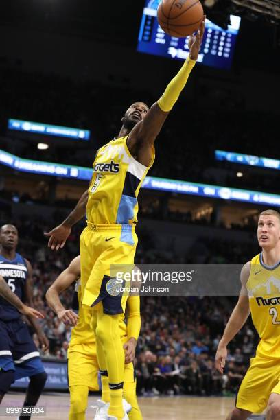 Will Barton of the Denver Nuggets goes for a lay up against the Minnesota Timberwolves on December 27 2017 at Target Center in Minneapolis Minnesota...