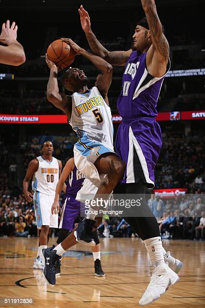 Will Barton of the Denver Nuggets goes up for a shot and is fouled by Willie CauleyStein of the Sacramento Kings at Pepsi Center on February 23 2016...