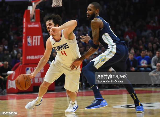 Will Barton of the Denver Nuggets guards Milos Teodosic of the Los Angeles Clippers as he takes the ball down court in the second half of the game at...