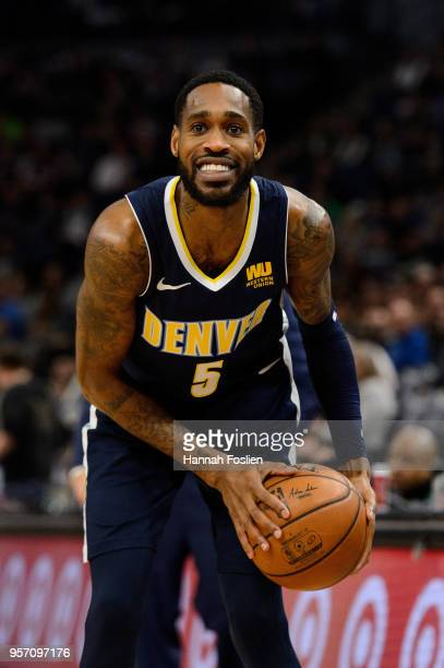 Will Barton of the Denver Nuggets handles the ball against the Minnesota Timberwolves during the game on April 11 2018 at the Target Center in...
