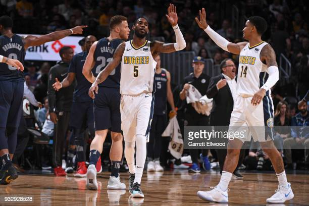 Will Barton of the Denver Nuggets highfives Gary Harris of the Denver Nuggets during the game against the Detroit Pistons on March 15 2018 at the...