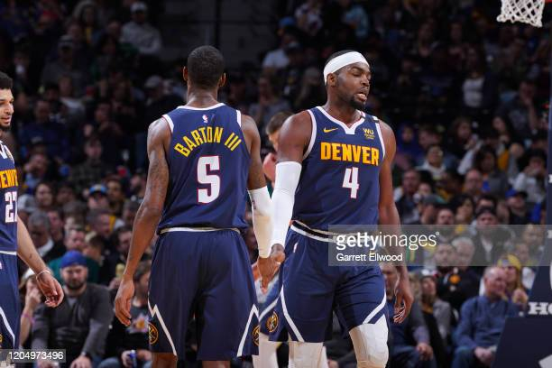 Will Barton of the Denver Nuggets highfives Paul Millsap of the Denver Nuggets on March 3 2020 at the Pepsi Center in Denver Colorado NOTE TO USER...