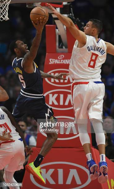 Will Barton of the Denver Nuggets is blocked by Danilo Gallinari of the LA Clippers in the first half during the season opening game at Staples...