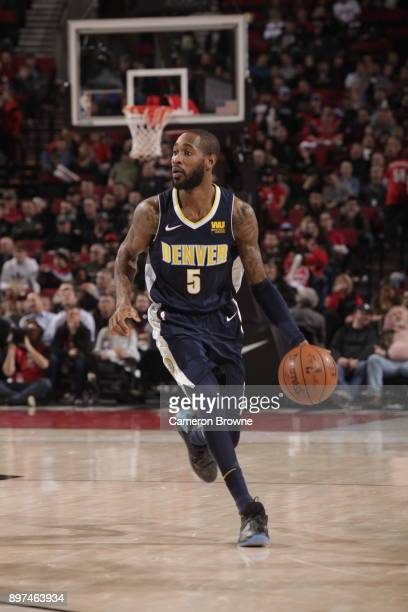 Will Barton of the Denver Nuggets jocks for a position against the Portland Trail Blazers on December 22 2017 at the Moda Center in Portland Oregon...