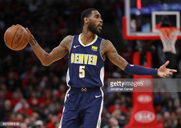 Will Barton of the Denver Nuggets looks to pass against the Chicago Bulls at the United Center on March 21 2018 in Chicago Illinois The Nuggets...