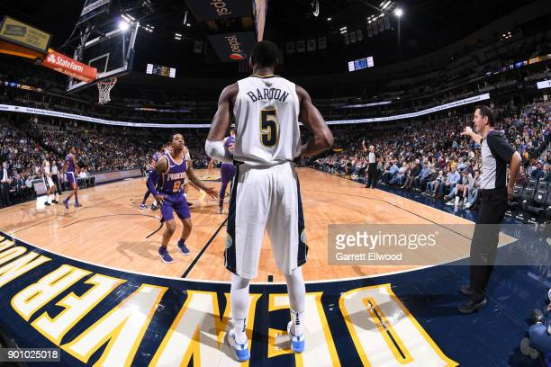 Will Barton of the Denver Nuggets looks to pass the ball against the Phoenix Suns on January 3 2018 at the Pepsi Center in Denver Colorado NOTE TO...