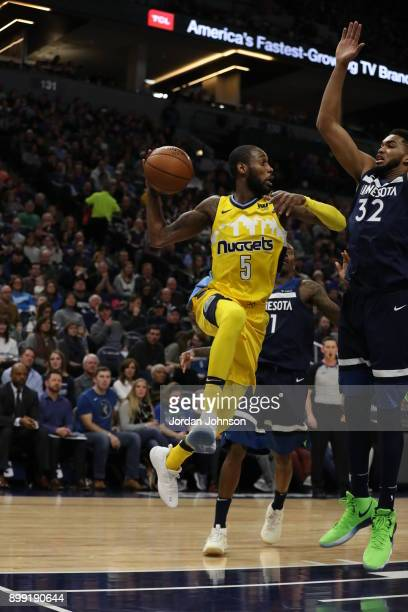 Will Barton of the Denver Nuggets passes the ball against the Minnesota Timberwolves on December 27 2017 at Target Center in Minneapolis Minnesota...