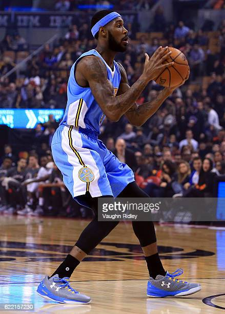 Will Barton of the Denver Nuggets passes the ball during the first half of an NBA game against the Toronto Raptors at Air Canada Centre on October 31...