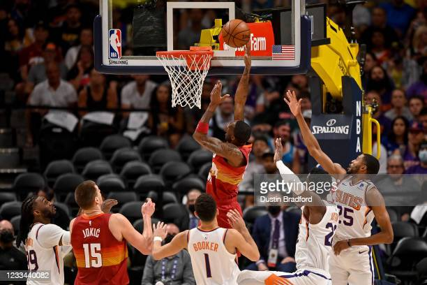 Will Barton of the Denver Nuggets scores on a layup in Game Four of the Western Conference second-round playoff series at Ball Arena on June 13, 2021...