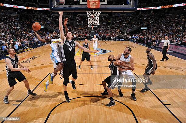 Will Barton of the Denver Nuggets shoots the ball against Boban Marjanovic of the San Antonio Spurs on April 8 2016 at the Pepsi Center in Denver...